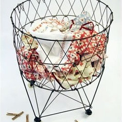 Moda Home Vintage Reproduction Collapsible Rolling Metal Laundry Basket - I'm planning to use this wire laundry basket as storage for my vintage linens.