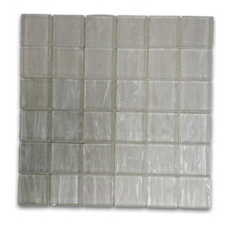 """GlassTileStore - Metallic Cosmic Dust 2x2 Glass Tile - Metallic Cosmic Dust 2x2 Glass Tile             These striking glass tiles give a luminescent quality to any bathroom or kitchen installation.These versatile tiles help create an elegant, custom look for any decor. You can also add an artistic and dramatic flair to the room.          Chip Size: 2"""" x 2""""   Color: Metallic White   Material: Glass   Finish: Polished   Sold by the Sheet - each sheet measures 12x12 (1 sq. ft.)   Please note each lot will vary from the next.            - Glass Tile -"""