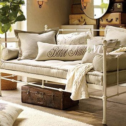 """Savannah Metal Daybed, Distressed Antique White - Embellished with open scrollwork and cast finials, our Savannah Daybed imparts welcome spaciousness and displays bedding beautifully. 80"""" wide x 42"""" deep x 43"""" high Constructed of iron tubing and bars to create a lighter version of the traditional iron daybed. Platform foundation is designed for use without a box spring Optional trundle rolls out on casters to create an additional sleep space for guests. View and compare with other collections at {{link path='pages/popups/bedroom_DOC.html' class='popup' width='720' height='800'}}Bedroom Furniture Facts{{/link}}. View our {{link path='pages/popups/fb-bedroom.html' class='popup' width='480' height='300'}}Furniture Brochure{{/link}}. Catalog / Internet Only."""