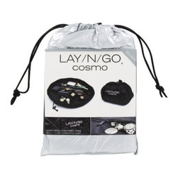 Lay-n-Go - Lay-n-Go Lite Orange Travel/Mini Activity Mat - Lay-n-Go LITE (patent pending) is an 18 inch travel/mini activity mat. Toy collections used on the Lay-n-Go surface are easily spread out for hours of fun at restaurants, on airplanes, in cars, at Grandma's house, etc. Once playtime is over, the drawstring is pulled and the activity mat is instantly converted back into a soft storage bag. Lay-n-Go LITE is small, but like its big brother/sister, it is a smart and easy personal activity mat, cleanup, storage and handy little carryall solution in one.