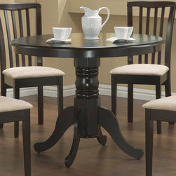 Coaster - Brannan Collection Dining Table in Cappuccino - With relaxed elegance, this round pedestal table will make a charming addition to your breakfast nook or casual dining room. The delicate carved detail and generous curves of this single pedestal offer graceful designs. Arrange with matching upholstered side chair to add a touch of contemporary flair. Available in a rich cappuccino.