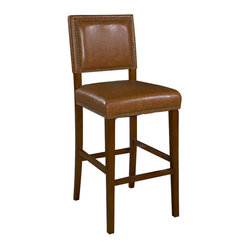 "Linon - Linon Brook 30 Inch Caramel Bar Stool in Brown - Linon - Bar Stools - 0233CARM01KDU - Create a contemporary or classical look in your kitchen dining or home pub area with the sleek shape and style of this medium walnut finish 30"""" Brook Counter Stool.   Solid wood legs give this courtly stool additional strength ensuring years of everyday use.  The padded cushion and seat back provides optimum comfort for you and your guests and is topped with durable caramel colored vinyl that is stain resistant fade resistant and features tightly woven threads that won't break mat or peel.   Classic nail head trim accents the stools lines."