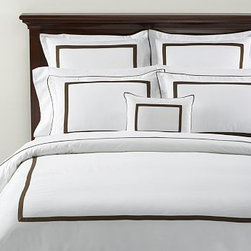 "Morgan 400-Thread-Count Duvet Cover, Full/Queen, Espresso - Our popular Morgan bedding is tailored with flat piping and a slim mitered border - a handsome frame for an embroidered monogram. 100% cotton percale. 400 thread count. Tailored with flat contrasting piping and a mitered border. Duvet cover has hidden faux-shell button closure and interior ties to keep the duvet in place. Sham has an envelope closure; insert is sold separately. Machine wash. Catalog / Internet only. Imported. Monogramming is available at an additional charge. Monogram is 3"" will be centered on the duvet cover and the sham."