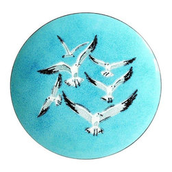 Used Mid-Century Modern Seagull Enamel Tray - A beautiful example of Mid-Century Modern design, this vintage, handcrafted enamel-on-copper tray was designed by AnneMarie Davidson in Sierra Madra, California. It features a field of sky blue with several flying seagulls. This piece is in beautiful condition with no flaws. It comes complete with the original felt feet on the bottom of the tray, plus an etched maker's mark and sticker.