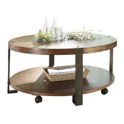 Homelegance - Homelegance Northwood Round Cocktail Table with Casters in Natural Brown - Blending industrial with natural elements creates a warm and inviting look for the Northwood collection. Mindi veneer is finished with a natural brown hue blending effectively with the contrasting metal banding accent. Carriage rivet accents lend to the industrial feel. Lower display shelving features prominently on each piece providing additional function to the collection. Three cocktail table options: Rectangular cocktail table, round cocktail table and round cocktail table with 2 ottomans, all feature functional casters for easy movement.