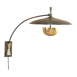 Global Views - Flying Wall Sconce - A feat of gravity, Global Views take on the arc lamp is bronze with brass detail. The sconce is hung in one place on the wall but the arched arm will rotate from left to right. Inspired by a UFO and 60's architecture. Takes two 60 watt bulbs.