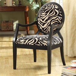 None - New Zebra Oval Back Chair - Lend your home an adventurous,safari-inspired look with this oval-back zebra chair. This wild and daring chair features hand-carved details on its wooden frame and a softly padded zebra print back and seat for added comfort and style.
