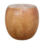 Kammika - Mango Wood Pouf/Side Table - Our unique Sustainable Mango Wood Pouf stool 20 inch Diameter Body x 16 inch Diameter Top x 14 inch Diameter Base x 18 inch Height with Eco Friendly, Natural Food-safe Livos Light Teak Oil Finish is both an element to be used for seating and for use as a table or stand. This oversized piece can serve as a stool, ottoman, or table. Hollow inside, it can easily be moved about. Finished in Livos Light Teak Oil, it�s water resistant and food safe surface is easily maintained with warm soapy water and an occasional light oiling or waxing. These natural oils are translucent, so the wood grain detail is highlighted. Polished to a matte finish, there is no oily feel; and cannot bleed into carpets, as it contains natural lacs. This versatile sturdy eco friendly functional art piece can also be used as a stand for a lamp or vase, and makes a unique plant pedestal. Designed for use stand alone or in groups, they can serve as a serving table or bench when put together. Small surface cracks and dark spots in the wood are natural. Appealing to the viewer from any angle, skilled craftspeople from the Chiang Mai area in Northern Thailand create these one-of-a-kind pieces with the simplest of tools. Each piece is a Work of Art! We make minimal use of electric hand sanders in the finishing process. Dried in solar or propane kilns, no chemicals are used in the process, ever. After each piece is carved, kiln dried, sanded, and rubbed with Livos oil, it is packaged with cartons from recycled cardboard with no plastic or other fillers. As this is a natural product, the color and grain of your piece of Nature will be unique, and may include small checks or cracks that occur when the wood is dried. Sizes are approximate. Products could have visible marks from tools used, patches from small repairs, knot holes, natural inclusions or holes. There may be various separations or cracks on your piece when it arrives. There may be some slight variation in si