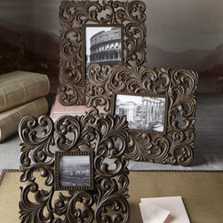 """GG Collection - GG Collection Medium Cast-Aluminum Frame - Medium-sized picture frame surrounds a favorite photo with elegant scrolls for a dramatic presentation. From the GG Collection. Handcrafted of cast aluminum. 12.25""""W x 0.65""""D x 10.25""""T; holds 4""""W x 6""""T photo. Imported."""