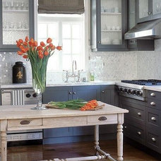 kitchens - white gray rustic wood island table glass front gray kitchen cabinets