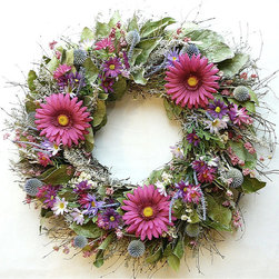 "Frontgate - Pretty in Pink Wreath - 24"" dia. - Grown, dried, and preserved in the Pacific Northwest, using only natural preservatives. Imaginatively designed and hand-assembled. Secured on a wire frame. Will maintain its fresh-picked appearance year after year. Only display in a covered area away from outdoor elements. A perfect blend of silk and dried flowers romances our Pretty in Pink Wreath. Bold pinks and purples are arranged in a full, lush arrangement that includes gerbera daisies, pink and purple cosmos, pale blue veronica, salal, echinops, quail brush twigs, artemisia, pink larkspur, and pearly everlasting.  .  .  .  .  . Made in USA."