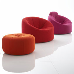 Pumpkin by Pierre Paulin | Ligne Roset - No pumpkin ever looked this cozy. Inspired by the round fruit, this chair has a solid polyurethane base that's covered in foam and upholstery. Options include a head rest, swiveling chair and ottoman.