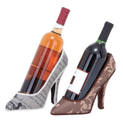 "Benzara - Shoe Wine Holder with Fine Detailing Work - Set of 2 - Add an interesting touch to your wine bottles with this Polystone Shoe Wine Holder which feature a chic contemporary design. The decorative appearance of these wine bottle holders make them ideal for blending in with dining and living rooms and even adding to bar settings for a distinctive appeal. These shoe holders are made from polystone of top quality which ensures a strong build that can offers years of use. They come in different finishes and patterns to make them distinctive in appearance and ensure the holders can blend in with different settings. Crafted by master artists, these holders are designed with fine attention to detail and modern styling which makes them ideal for complementing all kinds of urban settings.; Chic contemporary design; Designed with fine attention to detail and modern styling; Made from polystone of top quality; Strong build that can offers years of use; Different finishes and patterns; Weight: 1.65 lbs; Dimensions:10""W x 3.5""D x 7""H; 3.5""W x 3.5""D x 7""H"