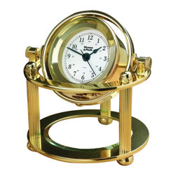 "Weems & Plath Solaris Desk Clock - The solaris desk clock measures 4 5/8"" x 5 1/4"" x 5 1/4"" and weighs 3 lbs 11 oz. This item encloses a precision quartz clock movement in a hand polished, forged brass and marine lacquered case. The gimbaled design allows the clock to swivel for any viewing angle, and it can be locked in place much like the historic gimbals that allowed clocks to travel safely at sea.  This show-stopper desk clock stands on three solid brass legs. There is a beveled glass crystal below the clock that can be etched to create an elegant personalized gift. The Solaris Desk Clock comes complete with a brass plate for even further personalization. This finely crafted clock is a unique gift that looks great on any desk, shelf, or table. A lifetime warranty is included to ensure you'll receive a lifetime of trouble-free service. N battery included."