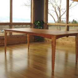 """Solid Cherry """"Prairie"""" Dining Table - Our """"Prairie"""" design adapts to any space with solid wood construction, boards hand-selected for color and grain, and our classic four-leg base with elegant arched aprons and tapered legs."""