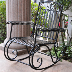 International Caravan - International Caravan Tropico Iron Rocking Chair - Rocking chair is constructed of durable ironPatio furniture features weather-resistant double powdercoated black finishOutdoor chair glides with a smooth rocking motion