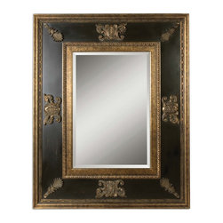 Uttermost - Cadence Gold Mirror - Decorate as richly and decadently as you wish to eat. The caviar of home decor, this stately framed mirror features gold leaf inner and outer edges along with indulgent ornaments along the thick frame. The distressed black finish allows you to claim family heirloom status.