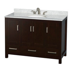 Wyndham Collection - Wyndham Collection WCS141448SES Sheffield 48-in. Single Bathroom Vanity - Espres - Shop for Bathroom Cabinets from Hayneedle.com! The Wyndham Collection WCS141448SES Sheffield 48-in. Single Bathroom Vanity - Espresso is going to be the focal point of your new washroom and it's ready for its closeup. This freestanding cabinet starts with a body of solid wood that's put through a 12-step preparation and finishing process that results in a versatile design that sports a deep espresso finish that's environmentally friendly and low in VOCs. Four doors open to reveal three open storage compartments and three pull-out drawers offer further storage. Each deeply doweled drawer slides on fully extendable metal glides so you can use every inch of interior storage. The drawers and doors all feature self-closing soft-touch latches. A full range of material and color options lets you customize the vanity top and undermount sink to your personal tastes. You even have the option of not purchasing either leaving you open to do some serious customizing on your own. Brushed chrome hardware pulls complement the espresso finish and give this cabinet an appealing contemporary look.Product Dimensions:Vanity dimensions with top: 48W x 22D x 35H in About the Wyndham CollectionWyndham and the Wyndham collection are all about refinement detailing uniqueness quality and longevity. They are dedicated to the quality of their products and own the factory where each piece is constructed. This allows Wyndham to offer products that reflect the rigorous quality standards required for every piece that is offered to their customers. The Wyndham collection showcases elegant modern design styles that highlight functionality and style in every detail.