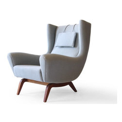 Illum Wikkelsø #110 Søren Willadsen Teak Easy Chair - Pale blue is the ultimate calming color, so I love that this sleek and curvy Danish arm chair is offered in such a relaxing shade of soft Danish wool. The chair envelopes the body with its wingback design for cozy comfort, so you get the best of both worlds. I'd like to see its softness played up in a room of pastel shades and touchable textures.
