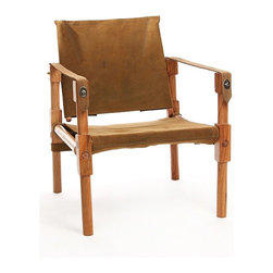 Ballard Campaign Chair - This chair can be broken down and toted from place to place, and the supple leather has such a warm feeling to it. I'd love to carry it out next to a fire pit.