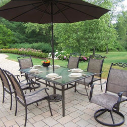 Oakland Living - 9-Pc Patio Dining Table Set - Includes rectangular dining table, four stackable dining chairs, two swivel rocker chairs, 9 ft. tilt and crank umbrella and stand. Durable sling and extruded rust-free aluminum construction. Metal hardware. Fade, chip and crack resistant. Warranty: One year limited. Coffee hardened powder coat finish for years of beauty. Minimal assembly required. Table: 72 in. W x 42 in. D x 29 in. H. Arm chair: 30.5 in. W x 24 in. D x 40 in. H (12 lbs.). Rocker chair: 30.5 in. W x 24 in. D x 40 in. H (16 lbs.). Overall weight: 130 lbs.The Oakland Cascade Collection combines style and modern designs giving you a rich addition to any outdoor setting. The Oakland Cascade Collection adds functionality and ease of use. The Oakland Cascade collection is perfect for any outdoor patio, back yard or garden. Each piece is hand cast and finished for the highest quality possible. This dining set will be a beautiful addition to your patio, balcony or outdoor entertainment area. Our dining sets are perfect for any small space or to accent a larger space.