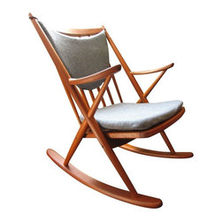 """Pre-owned Bramin Modern Rocker by Frank Reenskaug - This beautiful Danish Modern chair by Frank Reenskaug for Bramin Mobler will rock your world. The Mid-Century modern design features a teak frame and sculpted arms; a clean and sturdy piece imported directly from Denmark in 1958. It has the original cushions upholstered in a comfortable blue/grey wool fabric.     Seat height is 18"""" from the floor."""
