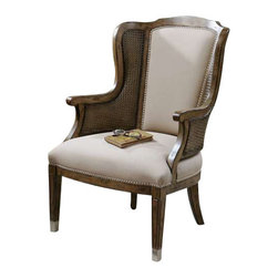 "Uttermost Nessa High Back Wing Chair - High back and curvy wings make a grand statement in a warm, sun washed pecan finish on solid, white poplar with cane sides and beige faux lambskin, accented by nickel nail head trim and metal tips on the grooved, tapered legs. High back and curvy wings make a grand statement in a warm, sun-washed pecan finish on solid white poplar with cane sides and beige faux lambskin, accented by nickel nail head trim and metal tips on the grooved, tapered legs. Seat height is 18""."