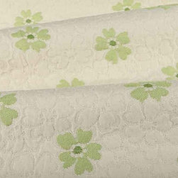 Shabby Floral Upholstery Fabric in Spring Green - Shabby Floral Upholstery Fabric in Spring Green is a ripple textured fabric with a smooth, hearty hand and a feminine floral pattern on a white base. This unique woven fabric is ideal for upholstering sofas and chairs or creating one of a kind bedding and pillows. Made from 39% rayon, 32% cotton, and 29% polyester, this fabric passes 15,000+ double rubs on the Wyzenbeek Abrasion Test. Cleaning Code: S; UFAC: Class I; passes CA117 Test. Width: 54″; Repeat: 5″ V