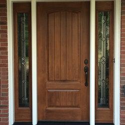 Entry Doors - Premium fiberglass entry door system. Aluminum clad exterior frame, Cherry grain, & Emtek gripset door latch.