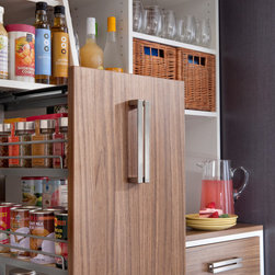 Pantry Pull-out Cabinet & Organizer - Your favorite foods are neatly stored in this pantry pull-out cabinet and organizer.  Essential kitchen products such as spices and cans are more easily accessible with transFORM's custom designed pantries.