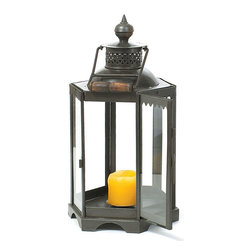 Small Black Lantern - This well-designed Small Black Lantern makes a captivating piece of vintage art form. It comes from our Antique European country collection and reflects a warm aura when lit with candle inside the lantern. The four-sided glass panels intensify the glare and emanate radiance in the surroundings.
