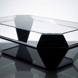 Alexandra von Furstenberg's Bullet Coffee Table - Alexandra von Furstenberg may have a famous ex mother-in-law ( Diane von Furstenberg ) but that hasn't stopped the designer from really coming into her own. Famous for having a penchant for lucite and playing with the realms of fashion and design, her new Bullet Coffee Table is infused with a rare dark energy as it seems to resemble a bullet inspired coffin! But maybe its my own morbid imagination that is seeing a resemblance with a coffin since the designer is aiming for something completely different. Von Furstenberg's Bullet is constructed of 18 clear acrylic panels which are precariously joint at each of the 18 junction to give an illusion of a life size diamond. Alexandra von Furstenberg's designs are not everyone's cup of tea but there is no denying that the designer shows flashes of genius when it comes to mixing fashion, fantasy and furniture.