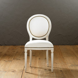 Ballard Designs - Oval Louis Side Chair with Aged Brass Nailheads - Hand crafted in Italy. Tapered fluted legs. Upholstered in the USA. Available in Off-White Twill. Special order in your choice of fabrics. Our elegant, oval-backed Louis Chairs offer enduring style that never succumbs to fickle trends. Inspired by Greek and Roman classicism the lines never tire and feel just as relevant today as they did 200 years ago. Each frame is hand crafted in Italy of solid beechwood with tapering fluted legs crowned in carved florettes. Hand applied aged brass nail head trim adds further detailing.Oval Louis Side Chair with Aged Brass Nails features: . . . . . Your choice of three leg finishes.