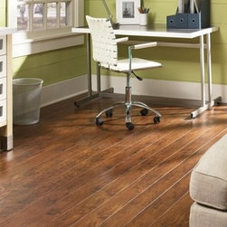 Texas Traditions Hickory Laminate - Vera Cruz - Just $3.85 / SF Installed. - True to its name, Prestige Illusions brings you the impression of a real hickory floor without the maintenance and cost of real wood. Available in two colors, the look of a beautiful, rustic hardwood floor can be achieved using laminate flooring.