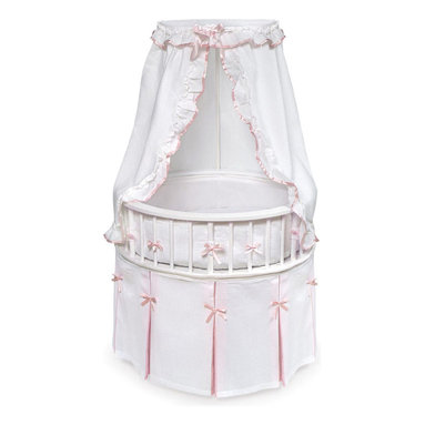 Badger Basket - White Elegance Round Baby Bassinet - White/Pink Bedding - The Elegance Bassinet is the most charming and unique place for your newborn to sleep! This special oval bassinet with a white finish is comfortable for Baby and stylish for your home. White waffle bedding set with just a hint of pink trim includes a lovely pleated skirt, soft bumper, fitted sheet, and drape canopy and a custom fitted, vinyl covered foam mattress pad.  Also includes caster wheels and storage shelf beneath. The Elite Bassinet can be used for infants up to 20 lbs or until Baby can push up/roll over. Easy assembly with illustrated instructions.