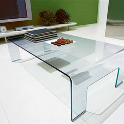 Calligaris - Real Glass Coffee Table - The answer to your home decorating needs is clear - the Calligaris Coffee Table has nothing to hide beneath its gracefully curved tempered glass arc.  Stylishly thin, the single piece of crystal clear transparent material is also satisfyingly tough. * Low coffee table entirely made from curved transparent glass giving it a sleek stylish look. Features a rectangular top with rounded corners. Assembly required. 25 W x 47 L x 13 H in.