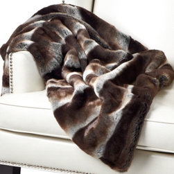 Z Gallerie - Zambia Throw - Faux in fur, but certainly not faux in warmth or softness, the chocolate Zambia Throw will take away the winter chill and replace it with a blanket of coziness.  The irresistible supple texture and layered earth tones make this blanket a functional decorative item for the home. Exclusive to Z Gallerie.