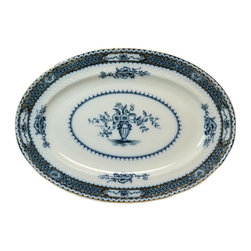 Faint company mark on base - Consigned Large Blue and White Porcelain Serving Platter with Gilded Decoration - Large oval porcelain serving platter with a molded border imitating a basket weave, decorated in blue and white and gilded, antique English Edwardian, early 1900s.This is an antique One of a Kind item. Some wear and imperfections are to be expected, as described.