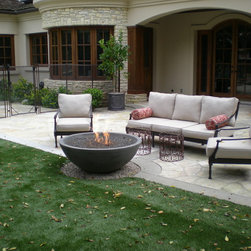 "Simplciity Fire bowl - Simplicity fire bowl  48"" wide x 15"" h with Lava gravel as a filler."