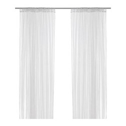 IKEA of Sweden - Lill Pair of Curtains - White gauze panels hung from ceiling to floor in the corners of a porch add a breezy touch.