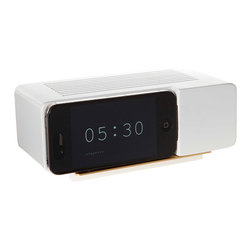 Jonas Damon - Alarm Dock - White - Jonas Damon - Remember those faux wood grain GE flip clocks that sat on every bedside table just a couple of decades ago? The Alarm Dock uses a nostalgic product language to meet the progressively thin and disappearing profiles of consumer electronics. It is at once a critique and an accommodation to new technology. Place an iPhone or iPod Touch running a flip clock app onto the dock, and see an iconic and meaningful form return to your nightstand, mantel, or shelf. Your iPhone or iPod's dock connector can be pulled through it, allowing your device to recharge while docked.