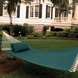 Pawleys Island Green Large Soft Weave Fabric Hammock - If you've ever wondered what it's like to sleep on a cloud, you can finally find out with the Pawleys Island Green Large Soft Weave Fabric Hammock. There's no coming back from the softness of this hammock. This solution dyed acrylic fabric is so comfortable you may just become a permanent fixture on it. The solid oak spreader bars feature a gorgeous finish for easy care and durability. Mildew and fade resistant, this super comfy hammock has beauty that lasts. With plenty of room for two, it won't be a chore to find someone to share in the comfort with you. Float away on a sea of relaxation with this hammock in your yard.About Pawleys IslandIn 1889, the Original Pawleys Island Rope Hammock was created at Pawleys Island, one of the oldest summer resorts on the South Carolina coast. When river boat pilot Captain Joshua John Ward found the grass-filled mattresses on his boat too hot in the summer, he decided to make a cool and comfortable cotton rope hammock to use on his boat. After several uncomfortable designs, Cap'n Josh made a hammock using wooden spreaders without knots. This original design has proven to be so comfortable, that it's still used in Pawleys Island's popular hammocks, over a century later.Pawleys Island continues to use the highest quality materials when making their traditional all-cotton rope, spun polyester rope, and DuraCord hammocks. Their custom-designed stretcher bars are cut from seasoned Carolina red oak, then steamed, bent, drilled, sanded, and varnished to impart a comfortable sway to the hammock and to spread the rope evenly for optimum stability.The people of The Original Pawleys Island Rope Hammock are incredibly proud to be anything but new-fangled. Now 120 years old and counting, they continue to offer the very best of their past hoping it will help you better enjoy your future.