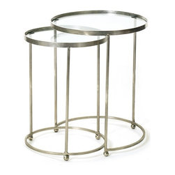 Set of Two Circle Nesting Tables - These circle nesting tables from the French country furniture collection come in the set of two. The steel make and polished nickel finish is the key feature of these innovatively designed tables. The round table top is the key feature of this uniquely designed table.