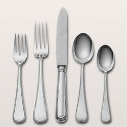 "Wallace Silversmiths - Five-Piece ""Palatina"" Sterling Silver Flatware Place Setting - Wallace SilversmithsFive-Piece ""Palatina"" Sterling Silver Flatware Place SettingDetailsA classic bead border traces the teardrop shape of this sterling silver flatware. Dishwasher safe. Made in the USA by Wallace Silversmiths.Five-piece place setting includes dinner fork salad fork dinner knife soup spoon and teaspoon.Designer About Wallace Silversmiths:For over 150 years Wallace Silversmiths has been renowned for its exquisite sterling silver and fine stainless steel flatware. Wallace artisans employ a centuries-old method of craftsmanship to ensure the flawless composition of every piece bearing their hallmark. Available in a wide selection of designs Wallace flatware is created for the discerning customer who appreciates beauty and tradition. From the understated to the ornate Wallace flatware's timeless styles reflect artistry from years past that continues to complement today's tables."