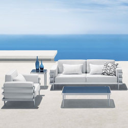 Contemporary Designed Outdoor Sofa and Lounge Chair Ensemble - The Revolution Collection from designer Fuxing Liang features an extruded aluminum frame and an anodized aluminum finish.