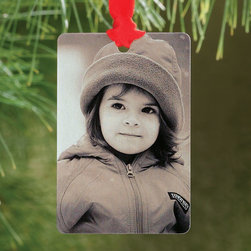 """Exposures - Tin Type Photo Ornament - Overview Capture an old-time feel with this tin type photo ornament. Your vertical photo is reproduced in sepia tones for a vintage effect. Red hanging ribbon. Features Tin type ornament Red satin hanging ribbon   Personalization  1 photo Photo is reproduced in b&w or sepia tones Vertical photo   Specifications  Measures 1 3/4"""" wide x 2 1/4"""" high Please allow an additional 2 to 3 days for personalized items"""