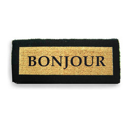 """""""Bonjour"""" Doormat - Unusual proportions make the French-speaking welcome of the """"Bonjour"""" Doormat more noticeable, greeting your guests with a crisp, contrasting black-and-natural palette and letting you know you're home with a lush, mud-catching texture. Place this traditional, handsome mat at the threshold to bring people through your door on a friendly, fashionable note."""