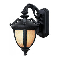 One Light Black Amber Mottle Glass Wall Lantern - With a striking design influenced from centuries past, this small outdoor wall mount is truly a work of traditional elegance. Finished in black, the majestic curves and feathered details work perfectly with the mottled amber glass, which casts a rich glow. Made of cast aluminum, these fixtures will stand up to all of nature's elements.