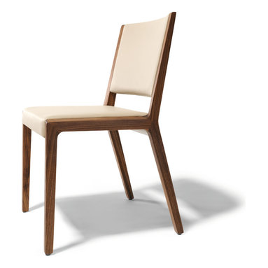 Eviva contemporary walnut chair - Beautiful luxury dining chairs with natural wood legs. Clever craftsmanship disguises the way the base panels are connected with the seat and back elements. It takes a great attention to detail to get craftsmanship this good - something Team7 aren't short of. And to top it all, Team7 operate a policy of sustainability that is hard to beat.