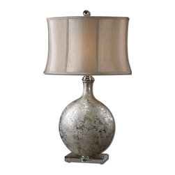 Uttermost - Navelli Silver Table Lamp - Can you have too much of a good thing? Can you pass up this lamp? Its base is like a rich tapestry of flowing silver. And then you notice the crystal foot and finial. Not to be outdone, the shade is a wonderful silken champagne bronze fabric. Life is good!